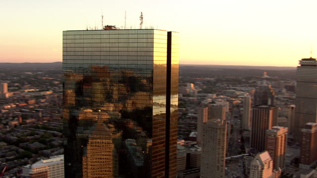 low aerial, boston downtown buildings at sunset, massachusetts, usa - back bay boston stock videos & royalty-free footage