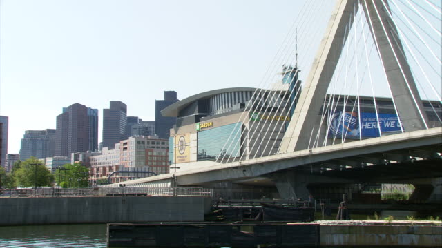 WS Boston Financial District skyline and TD Garden, formerly known as The Boston Garden, home of Celtics and Bruins, end of Zakim Bridge in foreground / Boston, Massachusetts, USA