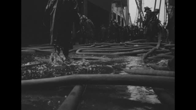 boston firefighters aim water hoses at smoldering brick building as they battle a fivealarm fire at the national wool company nearby building has... - fire hose stock videos and b-roll footage
