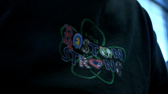 survivor interview usa int setup shots of marc fucarile taking off his prosthetic leg close shot of logo on marc's tshirt 'boston strong' fucarile... - on one leg stock videos & royalty-free footage