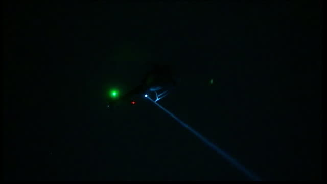 second suspect captured alive by police night air shot of search helicopter with thermal imaging flying overhead flashing searchlight - scientific imaging technique stock videos and b-roll footage