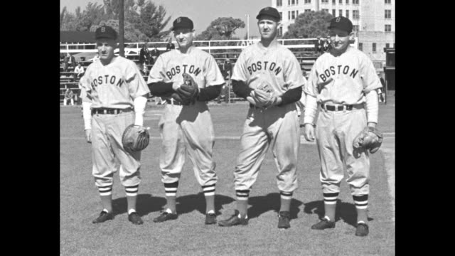 Boston Red Sox players practice on diamond during spring training in Florida / new players pose for photo and hit hands in gloves Frankie Pytlak...