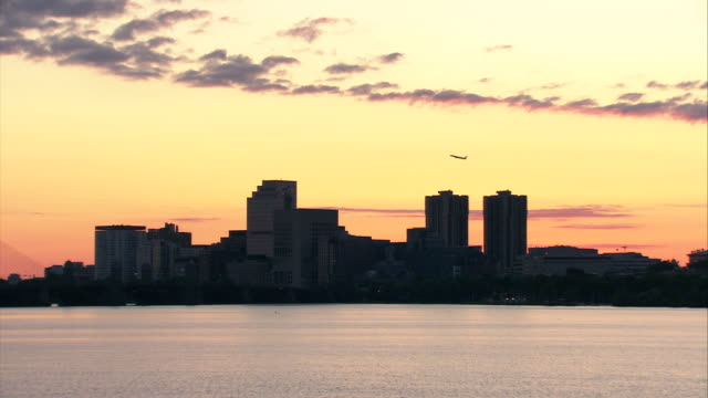 ws boston skyline across charles river at sunrise / boston, massachusetts, usa - river charles stock videos & royalty-free footage