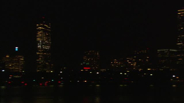 ws pan boston skyline across charles river with harvard bridge at night / boston, massachusetts, usa - river charles stock videos & royalty-free footage