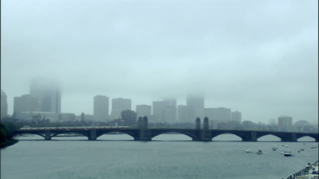 WS, Boston skyline across Charles River with Longfellow Bridge, foggy day, Massachusetts, USA
