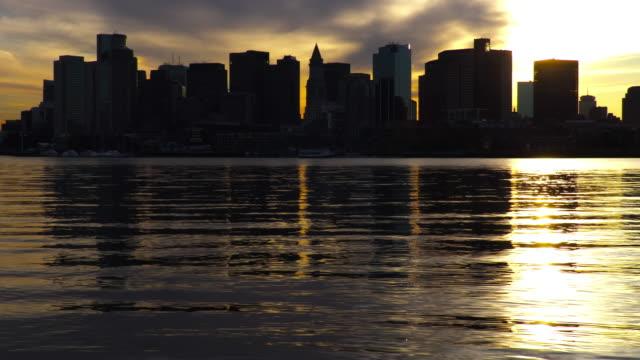 boston skyline along the harbor - custom house tower stock videos & royalty-free footage