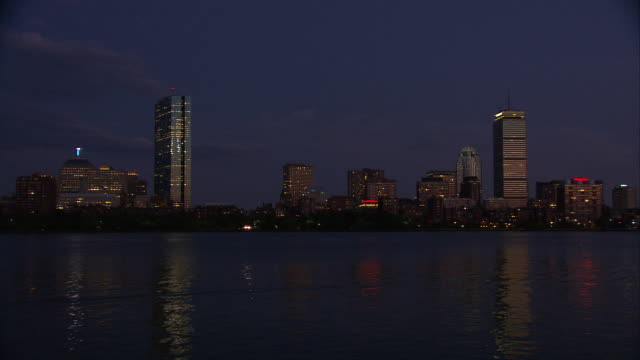 WS Boston skyline with Hancock Tower and Prudential Tower across Charles River at night / Boston, Massachusetts, USA