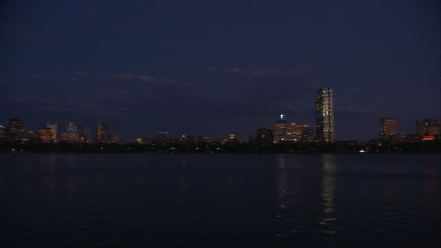 WS PAN Boston skyline with Hancock Tower and Prudential Tower across Charles River at night / Boston, Massachusetts, USA