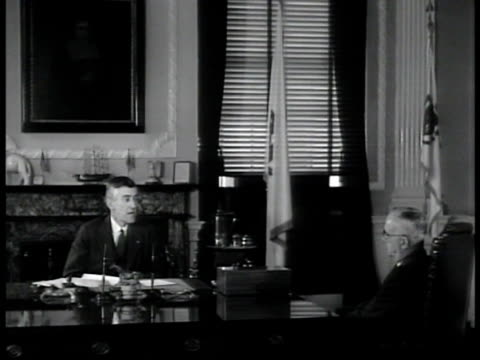 boston state house int governor leverett a saltonstall in office talking w/ commissioner of education julius e warren bulletin board 'governor's... - segregation stock videos & royalty-free footage