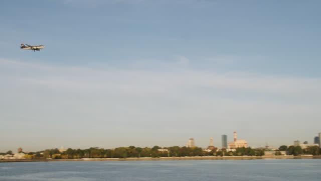 WS TS PAN Boston with plane passing across Charles river / Boston, Massachusetts, USA