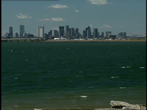 boston's skyline rises behind logan airport. - boston massachusetts stock videos & royalty-free footage