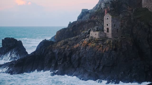 botallack tin mines, cornwall, england, with waves crashing on seashore cliffs, at sunset - coastline stock videos & royalty-free footage