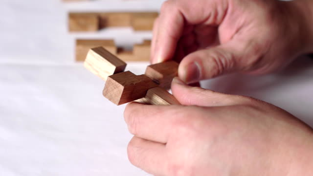 both hands, wooden sticks, ancient chinese architecture model - dismantling stock videos and b-roll footage