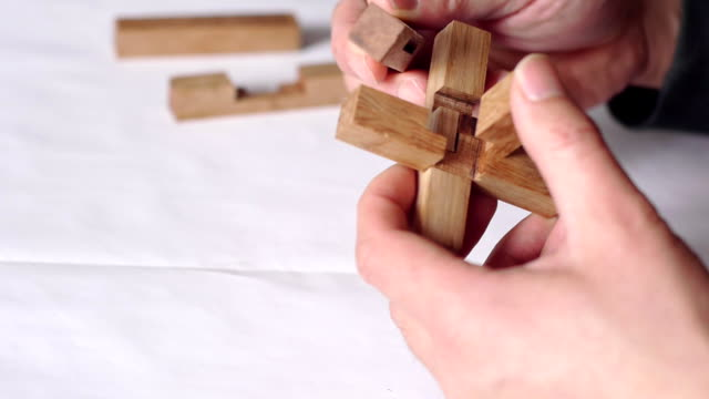 both hands, wooden sticks, ancient chinese architecture model - puzzle stock videos & royalty-free footage