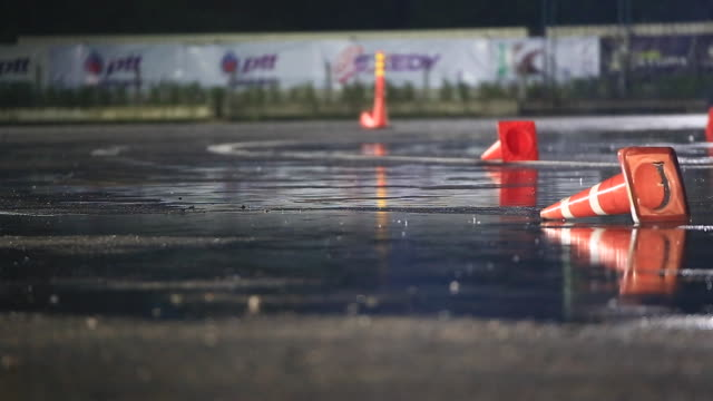 both racing cars drifting through the raining track - songkhla province stock videos and b-roll footage