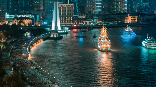 Both sides of the Huangpu River are ablaze with lights.
