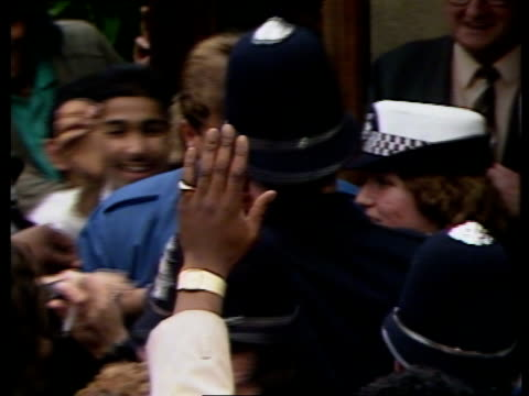 botham arives for sport aid match itn brimingham edgbaston ext botham signing autograph police holding back fans nat - autogramm stock-videos und b-roll-filmmaterial