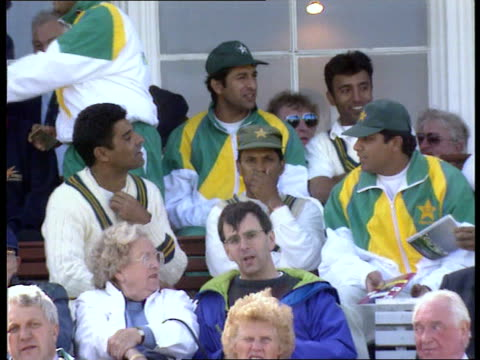 failed libel action; scotland edinburgh bv scottish player bowling pakistani batsman hits ball cms side spectators pakistani team seated watching... - pakistan stock videos & royalty-free footage