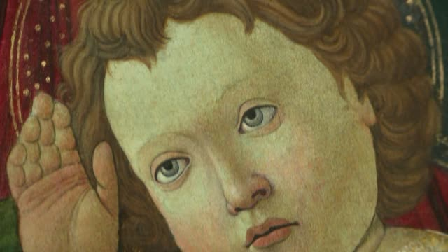 botticelli painting 'madonna of the pomegranate' restored after recognition as original england london int gvs 'madonna of the pomegranate' on easel... - staffelei stock-videos und b-roll-filmmaterial