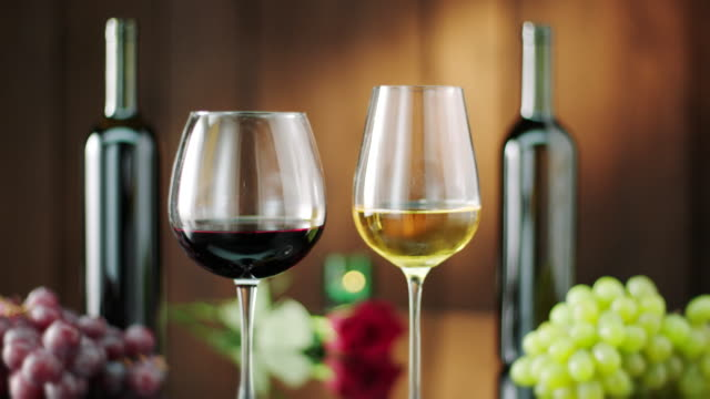 bottle and glass of red and white wine - white wine stock videos & royalty-free footage