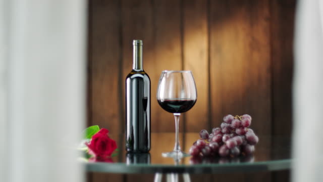 bottle and glass of red wine - wine bottle stock videos & royalty-free footage
