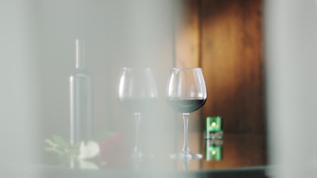 bottle and two glasses of red wine - rose wine stock videos and b-roll footage