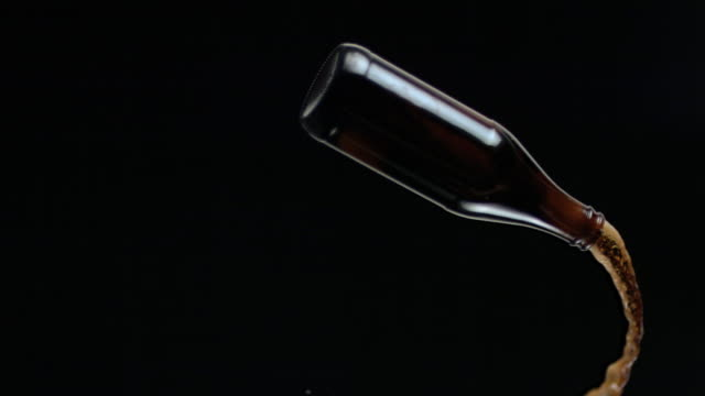 CU SLO MO Bottle of beer thrown in midair / New York City, New York, USA