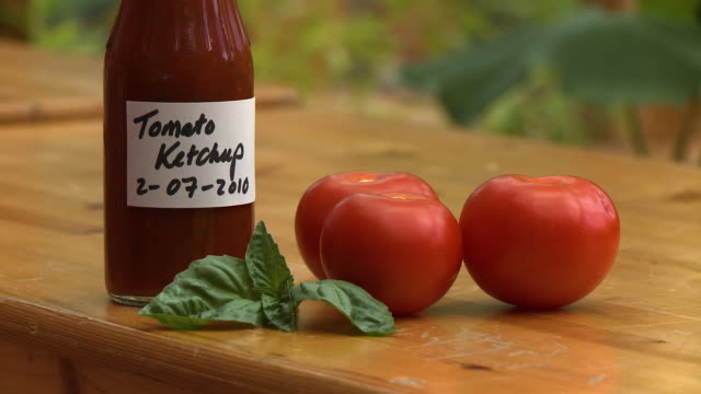 bottle of ketchup, tomatoes and basil leaves - 2010 stock videos & royalty-free footage