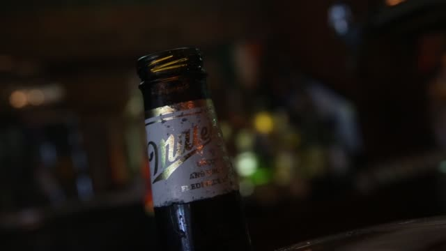 a bottle of miller high life beer sits at a bar on october 9 2015 in new york city budweiser's parent company ab inbev is attempting to buy sabmiller - beer bottle stock videos & royalty-free footage
