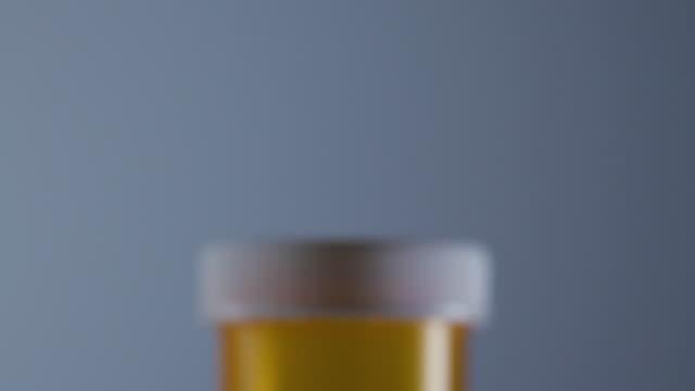 SLO MO CU TD Bottle of pills
