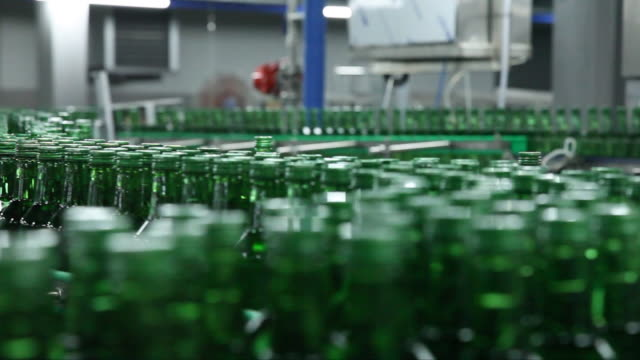bottled soju (korean alcohol) on conveyor belt at a manufacturing factory - bottling plant stock videos & royalty-free footage