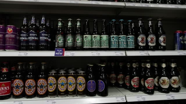 bottles and cans of british ale stand on display for sale inside the stonemanor british store in kortenberg belgium on friday march 31 2017 - ale stock videos & royalty-free footage
