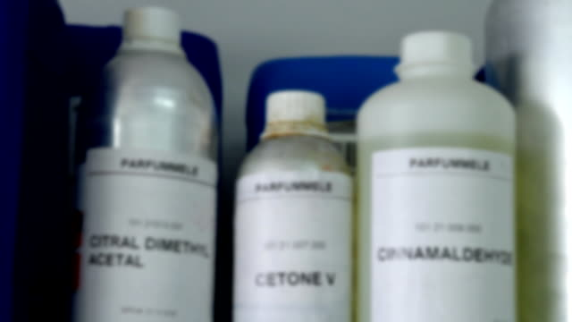 stockvideo's en b-roll-footage met bottles and containers of chemicals - shelf