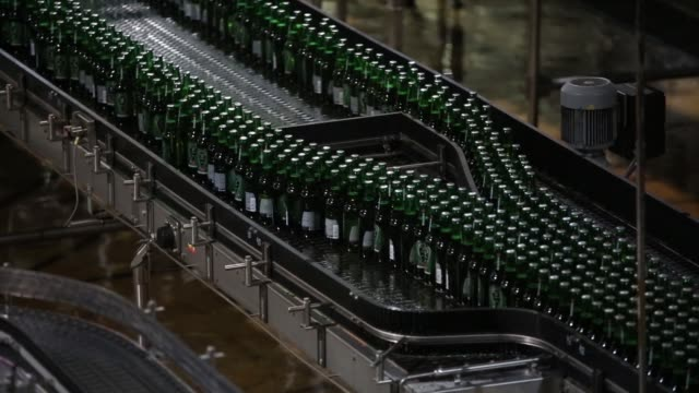 Bottles and crates of Heineken beer and Amstel Pilsner beer move along the production line at the Heineken NV brewery in Saint Petersburg Russia on...