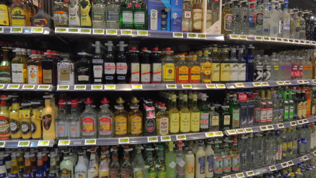 bottles arranged in liquor store - liquor store stock videos and b-roll footage