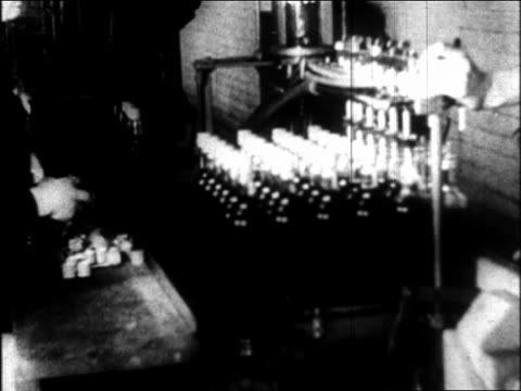 b/w 1933 bottles being filled with liquor/beer in distillery / repeal of prohibition - anno 1933 video stock e b–roll