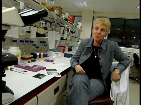bottles in lab at royal castle lung cancer foundation to christine owens and lab technician christine owens interview sot - 10,000 jobs been created... - roy castle点の映像素材/bロール