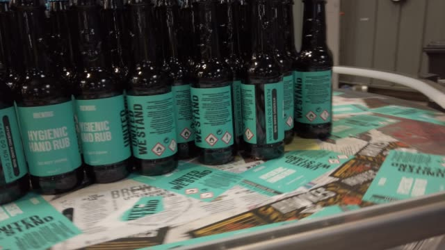 bottles move on the assembly line as workers at brewdog brewery pack hands sanitiser being produced at the plant during the coronavirus pandemic on... - production line stock videos & royalty-free footage