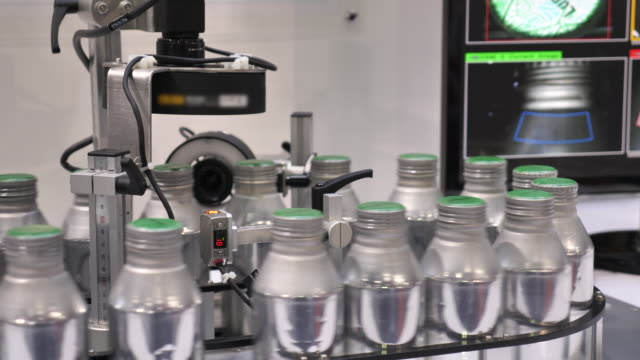 bottles moving on conveyor belt, image processing - water factory stock videos and b-roll footage