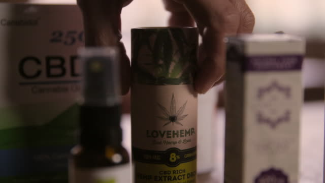 bottles of cbd are placed on a table - law stock videos & royalty-free footage