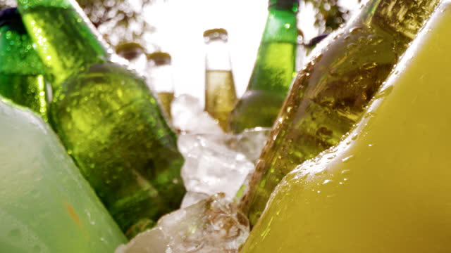 slo mo bottles of cold soft drinks in a cooler - cooler container stock videos & royalty-free footage