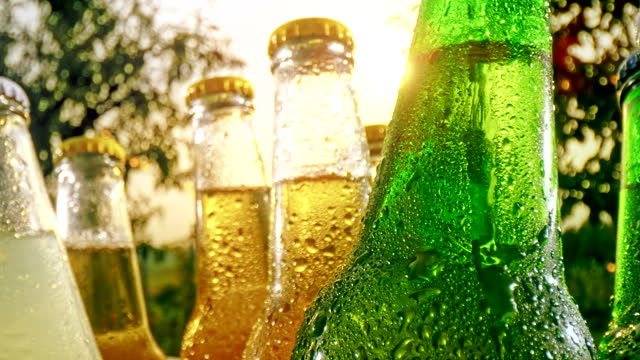 super slo mo bottles of cold soft drinks - bottle stock videos & royalty-free footage