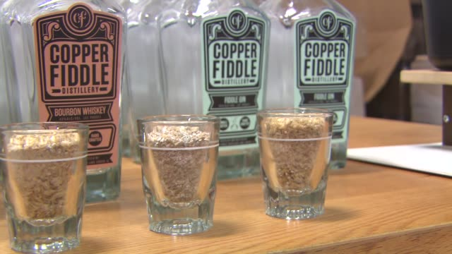 bottles of craft gin and whiskey at copper fiddle distillery on june 30, 2014 in lake zurich, illinois. - absinth stock-videos und b-roll-filmmaterial