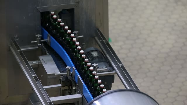 bottles of grolsch kornuit premium pilsner beer move along conveyors inside the grolsch brewery operated by sabmiller plc in enschede netherlands on... - pilsner stock videos & royalty-free footage