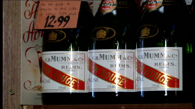 bottles of mumm & co champagne on shelves: boxes of london moet: other bottles of champagne: bottles of moet & oddbins chandon: taittinger champagne:... - champagne stock videos & royalty-free footage