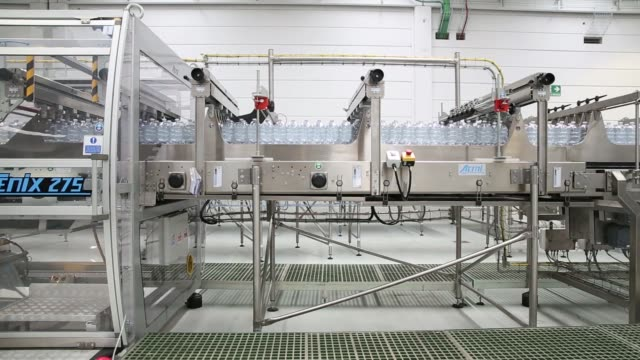 Bottles of Nestle Vera water move on the production line at the Nestle SA bottling plant in Castrocielo Italy on Tuesday July 5 2016