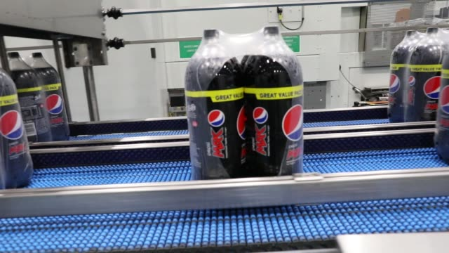 bottles of pepsi max travel along the production line at the britvic plc factory and warehouse in leeds, u.k., on monday, jan. 23, 2017 - plc stock videos & royalty-free footage