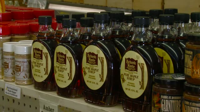 wjw bottles of pure maple syrup in a store in chardon ohio on february 19 2016 - maple syrup stock videos & royalty-free footage