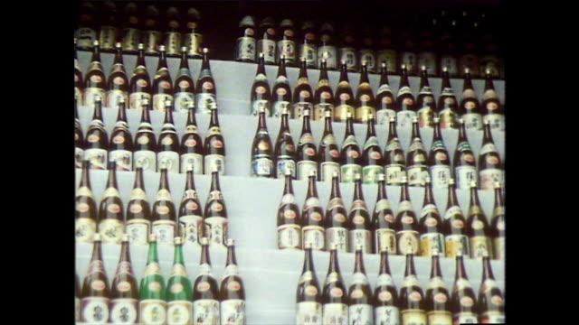 bottles of sake donated to japanese shrine; 1981 - shinto shrine stock videos & royalty-free footage