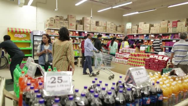 Bottles of soft drinks sit on shelves at a DMart supermarket operated by Avenue Supermarts Ltd in Thane Maharashtra India on Saturday Feb 13 CU...